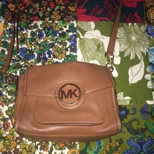 Michael Kors over the body camel colored purse